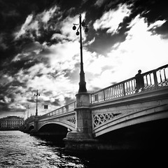 From A To B(ridge) (Peter Levi) Tags: bridge blackandwhite bw man blancoynegro water lamp clouds stream post sweden stockholm blackwhitephotos absoluteblackandwhite alwaysexc