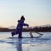 Winter light #3 (twoeye) Tags: light boy lake mountains cold reflection ice is getty spark bror kicksled prestvannet ginordicjan12