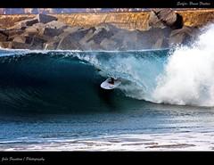 Tube riding (Joo Faustino) Tags: ocean blue sea praia beach portugal azul mar surf waves action surfer tube wave surfing ao riding rider tubo ondas oceano onda surfar