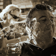 End game (Pjotre7 (www.maartenvandevoort.nl)) Tags: portrait bw woman man sunglasses sepia square mood wine expression cigar rook cinematic vrouw wijn sfeer sigaar 2011 pjotre7 storysmoke