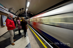 (Claire*Marsh) Tags: uk longexposure red people motion colour london station yellow speed train underground subway person movement transport tube wideangle line waterloo crowds commuters sigma1020mm