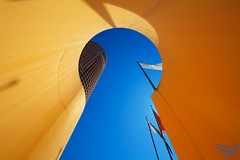 A curve tower (messinnicolas) Tags: city blue sky orange france color colour building tower window beautiful skyscraper canon eos key cityscape colours tour image lyon background flag great full entertainment round 5d crayon elegant fullframe curve length 16mm ville drapeau urbain courbe markiii courbes lcl grandangle tourcrayon