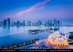 United Arab Emirates - UAE - Emirate of Sharjah - Cityscape around Khaled lagoon at Buhaira Corniche & Al Noor Mosque at Dusk - Twilight - Blue Hour - Night (© Lucie Debelkova / www.luciedebelkova.com) Tags: world travel light color building beach horizontal architecture modern night outdoors photography evening exterior view image dusk contemporary united uae scenic middleeast large landmark mosque structure illuminated east emirates international arab arabia vista innovation middle eastern luxury development sharjah unitedarabemirates built gcc locations prosperity thegulf destinations alnoormosque magiclight horizontals arabianpeninsula emirateofsharjah luciedebelkova wwwluciedebelkovacom