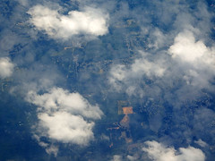 Looking Down at the Clouds and Land Below (soniaadammurray - SLOWLY TRYING TO CATCH UP) Tags: trees houses sky grass clouds fly earth aerialview vehicles land roads digitalphotography playingfields