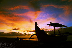 Sailing Through Firey Sky (Ricky Nugraha) Tags: sunset bali beach boat traditional baruna segara