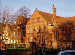 Queen's School, Chester, Dec 2008 (DizDiz) Tags: uk shadow england cheshire victorian chester q chimneys olympusc720uz countytown metalfences
