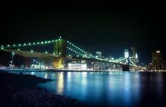 The Reflection of Brooklyn Bridge and Lower Manhattan (Yohsuke_NIKON_Japan) Tags: nyc longexposure bridge light usa ny reflection architecture night river nikon manhattan sigma brooklynbridge eastriver nightview wallstreet  vignette lowermanhattan bicolor    10mm    colorefex   d3100