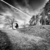 Afterburn.. (Peter Levi) Tags: road blackandwhite bw man tree blancoynegro sweden stockholm hill gravel afterburn absoluteblackandwhite absolutegoldenmasterpiece asquaresuperstarstemple