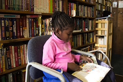 Black Girl Reading a Book in Bookstore Argos Books Trip With Daddy December 31, 2011 2 (stevendepolo) Tags: black girl shop reading book books bookstore grandrapids easthills lourdie 2011yip argosbooks