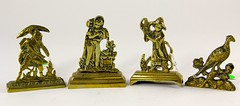 61. Miniature English Brass Doorstops