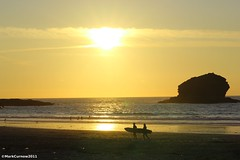 Portreath Surfers (Mark Curnow Photography) Tags: light sunset sea summer sun beach evening warm cornwall surf waves view surfers rays kernow portreath gullrock markcurnow