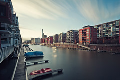 As The Clouds Passed By (Philipp Klinger Photography) Tags: longexposure bridge blue light shadow red orange sun plant water glass lines architecture modern triangles skyscraper canon reflections river germany boats deutschland boot pier boat am triangle long exposure sailing shadows hessen slow geometry frankfurt main ferrari boote line filter nd slowshutter shutter sail fluss philipp heating modernarchitecture westhafen frankfurtammain segelboot frankfurter hightower hesse langzeitbelichtung sailingboat botschaft klinger canon1740l canon1740mmf4l gerippte heatingplant flus geripptes lzb canon1740mml nd110 frankfurterbotschaft dergerippte 5dmarkii 5dmkii 5dmk2 5dmark2