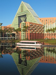 The Dolphin (Brian Utesch (shutterBRI)) Tags: blue sky reflection water canon reflections hotel boat orlando epcot still dolphin disney resort wdw waltdisneyworld lotusphere 2012 waltdisney shutterbri brianutesch ls2012