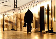 Train passenger in a golden world (Amsterdam RAIL) Tags: man station person gare eveningsun perron platform bahnhof human trainstation aachen lonely stazione goldenhour avondzon aachenhbf