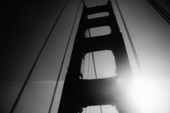 Golden Gate Bridge (Leighton Wallis) Tags: sanfrancisco california birthday ca blackandwhite usa sun tower silhouette unitedstatesofamerica outoffocus goldengatebridge oof 75thanniversary ggnpc11