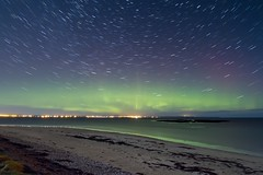 Northern Lights Trails 2 (Colin Cameron ~ Photography ~) Tags: nightphotography reflection green beach water stars scotland colours stack glowing northernlights isleoflewis startrails stornoway auroraborialis canon7d tamron1024mm