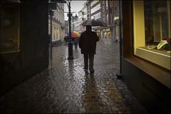 Vorbergehend (ajurgenowski) Tags: urban rain dark deutschland pluie sombre rainy aachen nrw nordrheinwestfalen regen dunkel strassenszene aixlachapelle regenwetter muensterplatz pluvieux northrhinewestfalia streetscenery aaken rhnaniedunordwestphalie