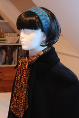 Sophie's new hairdo (Yersinia) Tags: scarf knitting head crochet sophie bob fringe wig cloak dropstitch regia kaffefassett headband polystyrene scarface sockyarn poundland ribbonyarn poundstretcher tunisiancrochet afghanstitch sophiescarface winterdeal