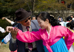 DANSE DE L AIGLE DANS UN PAR DE PYONGYANG, COREE DU NORD (Eric Lafforgue Photography) Tags: voyage travel woman color colour girl horizontal asia dress robe feminine femme hanbok asie custom 2008 fille couleur northkorea ideology axisofevil pyongyang eastasia feminin dprk traditionalclothing juche coleur dictature democraticpeoplesrepublicofkorea northkoreans koreanpeninsula juchesocialistrepublic coreedunord rdpc koreanethnicity insidenorthkorea joseonot