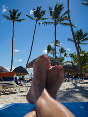 Had my feet up in Punta Cana (AR_the old guy) Tags: blue trees vacation sky feet beach sand raw dominican republic palm shade punta cana toned lounger