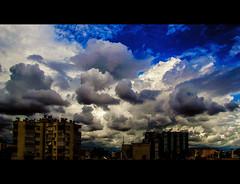 The nicest day (Melissa Maples) Tags: blue sky cinema skyline clouds turkey movie spring nikon asia rooftops widescreen trkiye antalya letterbox nikkor cinematic 169 vr afs  18200mm  f3556g  18200mmf3556g d5100
