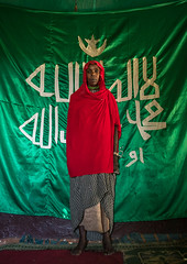 Sufi woman worshipper in front of islamic green flag, Harari region, Harar, Ethiopia (Eric Lafforgue) Tags: africa red portrait people woman color green vertical scarf outdoors photography women day adult african flag muslim islam faith religion unescoworldheritagesite indoors shawl spirituality ethiopia sufi sufism worshipper oneperson developingcountry hornofafrica ethiopian harrar eastafrica placeofworship harar abyssinia arabiccalligraphy traditionalclothing onewomanonly lookingatcamera fulllenght harari oromo 1people harer onlywomen harariregion oneadultonly hararjugol ethio162908