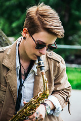Young woman playing the saxophone (PrgomeljaDusanAna) Tags: light portrait people musician music woman white black girl beautiful beauty hat fashion lady female club standing hair studio person clothing concert model pretty artist play adult expression background performance young jazz blues style entertainment musical human talent sound instrument attractive elegant performer sax brass saxophone isolated elegance caucasian saxophonist
