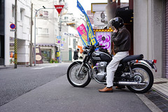 Kawasaki rider (Eric Flexyourhead (shoulder injury, slow)) Tags: street city urban man detail guy bike japan zeiss person japanese backstreet dude motorbike motorcycle  biker osaka kansai rider umeda kawasaki fragment kitaku shallowdepthoffield   osakashi  55mmf18  sonyalphaa7 zeisssonnartfe55mmf18za