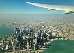 Through the window.. Doha Qatar! (katjakarumoholm) Tags: city water skyscraper airplane flying traveling doha qatar throughthewindow iphoneshot