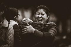 ADF_20140301_0568-2 (chiyowolf) Tags: chengdu sichuanprovince canoneos7d china ef70200mmf28lisiiusm streetscenes facesofchengdu peopleofchengdu portrait motherandchild bigsmile blackandwhite parenting 中国 travelphotography 成都 四川
