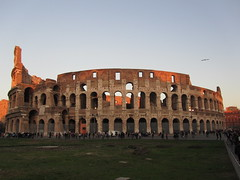 Sunset at the Colosseum in Rome. (Vagelis Pikoulas) Tags: city november autumn sunset sky italy sun rome roma bird canon landscape europe view south capital colosseum sx210is