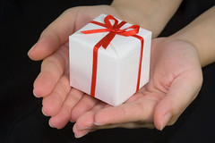 birthday christmas xmas decorations hands body parts grant award wrap give offer celebration gift present boxes celebrate isolated containers donate bestow