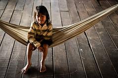swing little girl (Damian Bere) Tags: travel girl cambodia child swing hammock planks riverlife