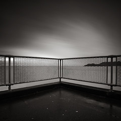 Behind The Barriers (Andy Brown (mrbuk1)) Tags: longexposure cloud seascape fence dark square mono blackwhite movement moody mesh contemporary horizon plymouth ground symmetry minimal devon moire simple lowkey railings damp bold zonesystem splittone neutraldensity nd110