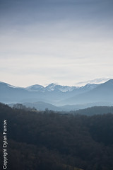Rolling Hills (Dylan Farrow) Tags: blue winter france mountains french still zoom hills compression distance pyrenees pixelpost flickrpost 450d sentous