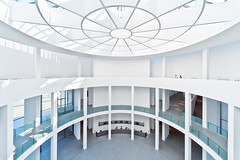 The White Hall (Philipp Klinger Photography) Tags: blue windows light shadow people urban woman white window glass lines wheel museum architecture modern germany circle munich mnchen bayern deutschland bavaria hall high nikon women key europa europe pattern angle bright geometry oberbayern pillar wide entrance wideangle symmetry ceiling line moderne symmetrical highkey curve curved pillars der philipp ultra sigma1