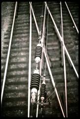 Train tracks (polapix) Tags: 35mm canon polaroid 50mm switzerland highcontrast railway basel t90 expired bahn polagraph instantslidefilm