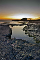 Burnt out over Bamburgh (Martin Steele.) Tags: ocean light sea england sky sun reflection castle beach nature water beauty rock clouds sunrise canon coast sand sigma northumberland karma cloudless filters northeast bamburgh 1020 hitech burntout leadinline 450d