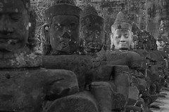 Odd Man Out (John S Pemberton) Tags: statue ruins cambodia khmer buddhism angkorwat carving temples siemreap stonefaces khmerculture