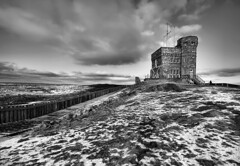 Castle on the Hill (Karen_Chappell) Tags: winter blackandwhite bw snow canada castle fence newfoundland landscape scenery january scenic stjohns wideangle atlantic signalhill nfld parkscanada cabottower nationalhistoricsite
