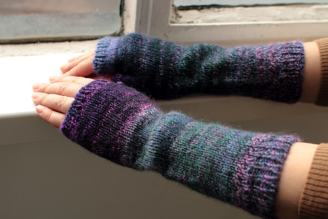 Long fingerless mittens in hand spun merino wool