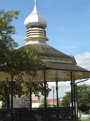 The Queen Alexandra Bandstand - Sturt Street, Ballarat (raaen99) Tags: city roof music detail building tree green tower leaves yellow architecture silver vent iron branch shingles wroughtiron decoration australia victoria gazebo artnouveau musical tiles dome historical oniondome nouveau bandstand rotunda 20thcentury nationaltrust oaktree edwardian ballarat goldrush 1908 1900s ornamentation veleta rooftiles countryvictoria coreto twentiethcentury heritagelisted silverplated sturtstreet sturtst bottlegreen silvered heritagegreen banderuola queenalexandra moorishdesign russiandesign musicallyinspired edwardiana provincialvictoria wetterfahnen primroseyellow queenalexandrabandstand russianinspired alexandrabandstand moorishinspired musicalmotif