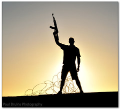 Freedom Fighter (Panorama Paul) Tags: sunrise terrorist barbedwire machinegun ak47 freedomfighter nohdr sigmalenses nikfilters nikond300 wwwpaulbruinscoza paulbruinsphotography