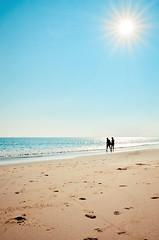 Paradise (A. adnan) Tags: guangzhou china love beach water walking sand couple sunny guangdong romantic beachside silhuette sunstar zhapo gettyimageschinaq12012 gettyimagesbangladeshq12012