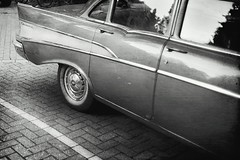 In the back of that car (Sator Arepo) Tags: leica blackandwhite holland classic chevrolet netherlands car amsterdam 35mm vintage 60s classiccar wheels rangefinder chevy mysterious vehicle holanda elegant summilux sixties m9 pavestones preasph leicam9