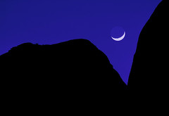 "Crescent moon setting between 2 mountains (IronRodArt - Royce Bair (""Star Shooter"")) Tags: new eve blue sky moon silhouette night evening twilight crescent setting lunar waxing crescentmoon"