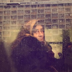Les yeux de la pluie (Cristian tefnescu) Tags: street old portrait woman reflection window wet rain square sadness drops spring eyes sad alt fenster strasse samsung tram squareformat older oma augen frau sbahn granny streetcar dame bloc spiegelung bucharest android regen bucuresti trist strassenbahn s2 tropfen ochi bukarest plattenbauten fruehling nass primavara traurig oglinda bunica batrana reflexie traurigkeit ploaie wohnblock tramvai geam tristete stropi bildniss instagramapp uploaded:by=instagram