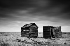 Old Friends (benjeev) Tags: uk blackandwhite bw abandoned beach broken monochrome dark landscape wooden moody huts dungeness dilapidated patience rundown fallingapart dappledsky