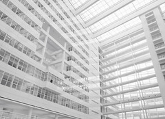 Futuristic (B.Jansma) Tags: light bw white black building lines architecture floors photoshop canon silver licht high key raw bright shapes denhaag sharp pro zwart wit thehague futuristic architectuur gebouw lightroom zw 500d toekomst futuristisch ijspaleis stadshuis efex etages
