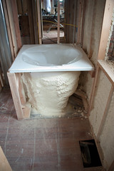 Foamy tub (EyePulp) Tags: brick illinois construction unitedstates interior object plumbing insulation location structure manmade framing electrical studs 2x4 lumber remodeling naturalgas towanda gaspipe churchhome closedcellfoam